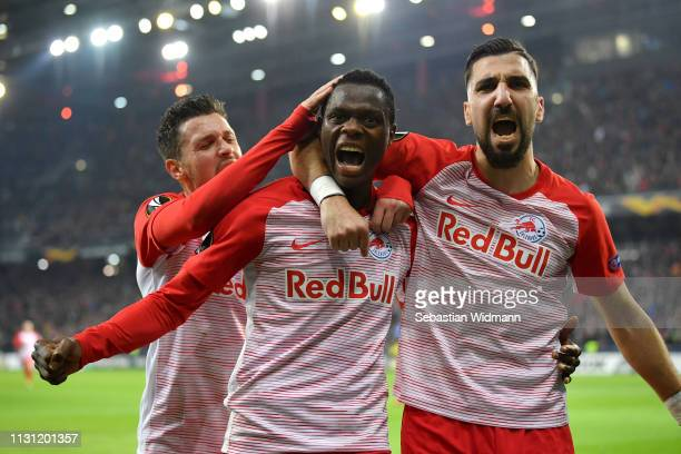 Patson Daka of RB Salzburg celebrates after scoring his team's second goal with Zlatko Junuzovic and Munas Dabbur of RB Salzburg during the UEFA...