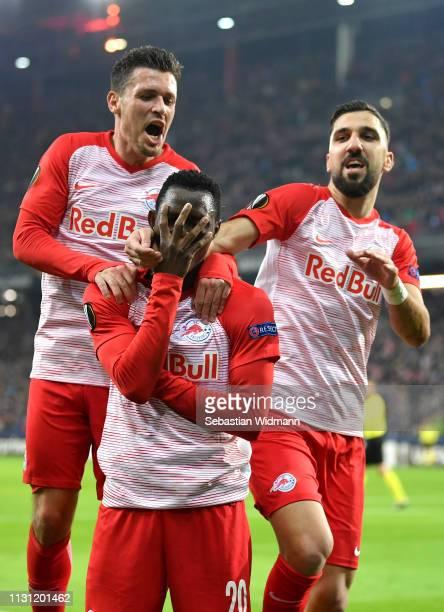 Patson Daka of RB Salzburg celebrates after scoring his team's second goal with Zlatko Junuzovic and Munas Dabbur of RB Salzburg during the UEFA...