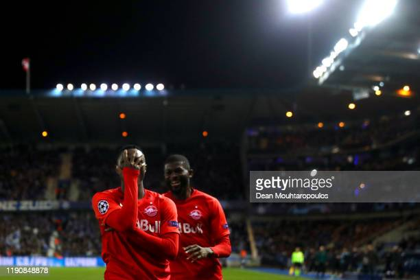 Patson Daka of RB Salzburg celebrates scoring his teams first goal of the game with team mates during the UEFA Champions League group E match between...