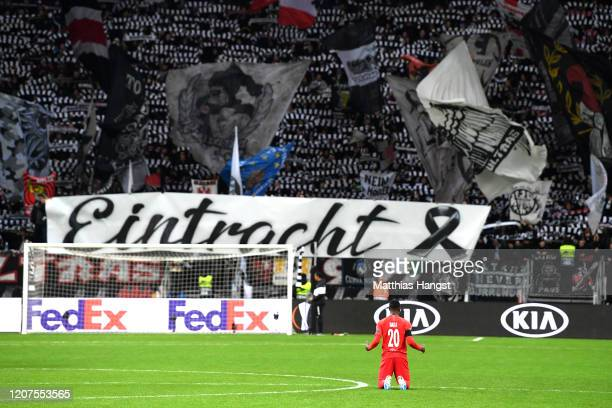 Patson Daka of RB Salzburg prays before the match as fans pay tribute to the victims of the Hanau shootings prior to the UEFA Europa League round of...
