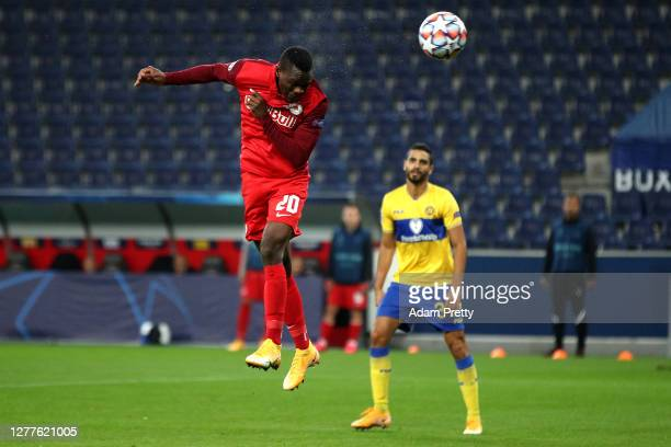 Patson Daka of RB Salzburg scores his sides third goal during the UEFA Champions League Play-Off second leg match between RB Salzburg and Maccabi...