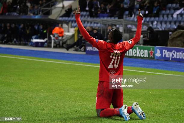 Patson Daka of Red Bull Salzburg celebrates after scoring his team's first goal during the UEFA Champions League group E match between KRC Genk and...
