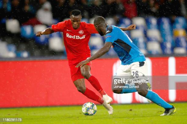 Patson Daka of Salzburg and Kalidou Koulibaly of Napoli during the Group E UEFA Champions League match between SSC Napoli and RB Salzburg at Stadio...