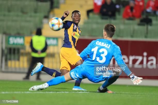 Patson Daka of Salzburg and Tino Casali of Mattersburg compete for the ball during the tipico Bundesliga match between SV Mattersburg and FC Red Bull...