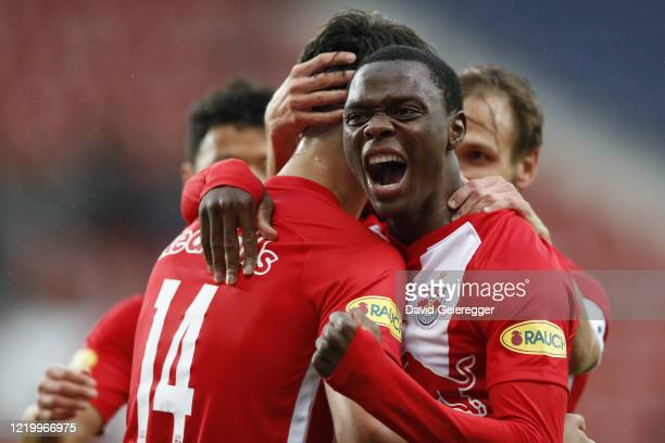 Patson Daka of Salzburg celebrates with his teammate Dominik Szoboszlai of Salzburg after scoring during the tipico Bundesliga match between Red Bull...