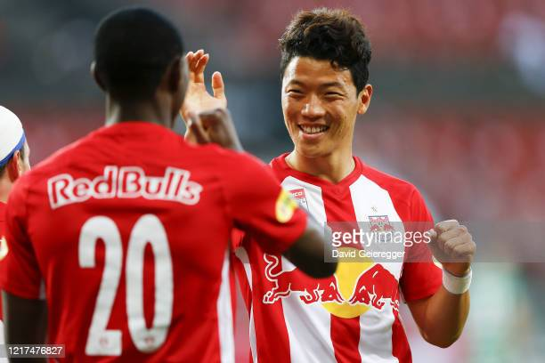 Patson Daka of Salzburg celebrates with his teammate Hee Chan Hwang of Salzburg after scoring the opening goal during the tipico Bundesliga match...