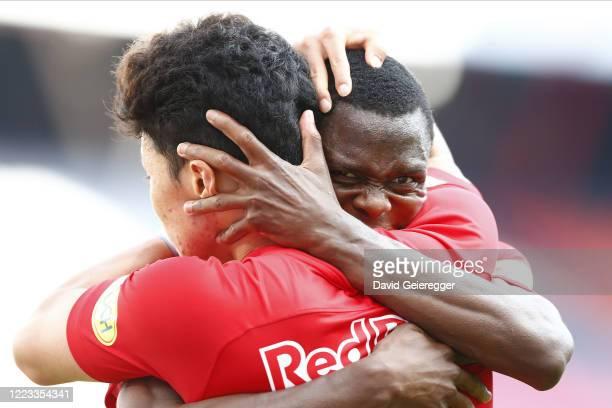 Patson Daka of Salzburg celebrates with his teammate Hee Chan Hwang of Salzburg after scoring during the tipico Bundesliga match between Red Bull...