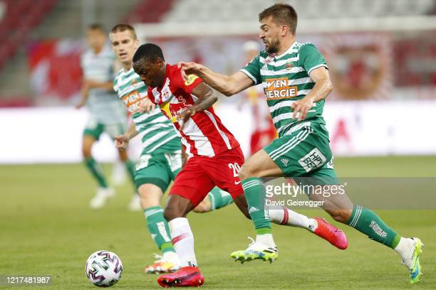 Patson Daka of Salzburg challenges Filip Stojkovic of Rapid during the tipico Bundesliga match between Red Bull Salzburg and SK Rapid Wien at Red...