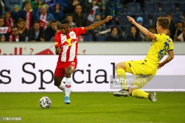 Patson Daka of Salzburg controls the ball in front of Daniel Drescher of St Poelten during the tipico Bundesliga match between FC Red Bull Salzburg...