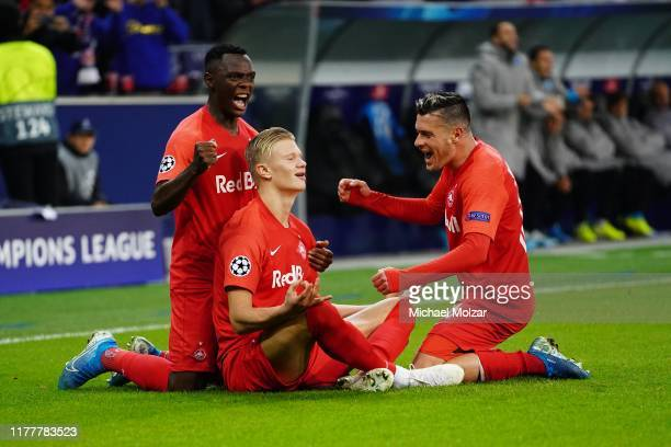 Patson Daka of Salzburg Erling Braut Haaland of Salzburg and Zlatko Junuzovic of Salzburg are celebrating the goal to tie the game during the Group E...