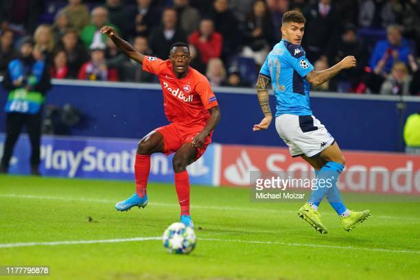 Patson Daka of Salzburg misses a shot and Giovanni Di Lorenzo of SSC Napoli during the Group E UEFA Champions League match between Red Bull Salzburg...