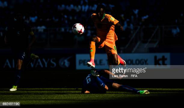 Patson Daka of Zambia jumps over Mauro Coppolaro of Italy during the FIFA U-20 World Cup Korea Republic 2017 Quarter Final match between Italy and...