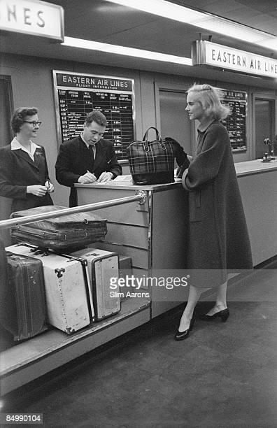 Patsy Pulitzer checking in at the airport Palm Beach Florida circa 1955