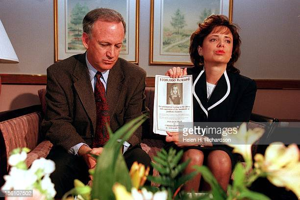 Patsy Ramsey holds up a reward sign for any information leading to the arrest of their daughter JonBenet Ramsey in Boulder Colorado on May 1 1997 The...