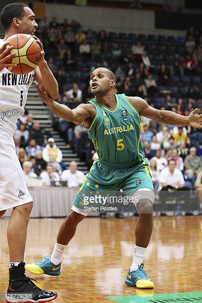 Patt Mills of the Boomers defends Everard Bartlett of the Tall Blacks during the Men's FIBA Oceania Championship match between the Australian Boomers...