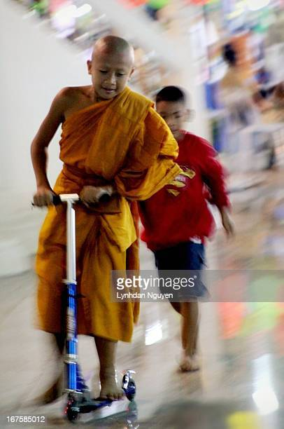 CONTENT] Pattaya Thailand A novice monk having hun