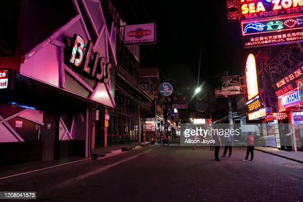 Pattaya Walking Street a normally busy bar and party street is mostly empty on March 23 2020 in Pattaya Thailand On March 18th Pattaya announced the...