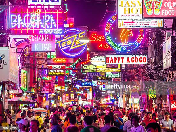 pattaya walking street in thailand - red light district stock photos and pictures