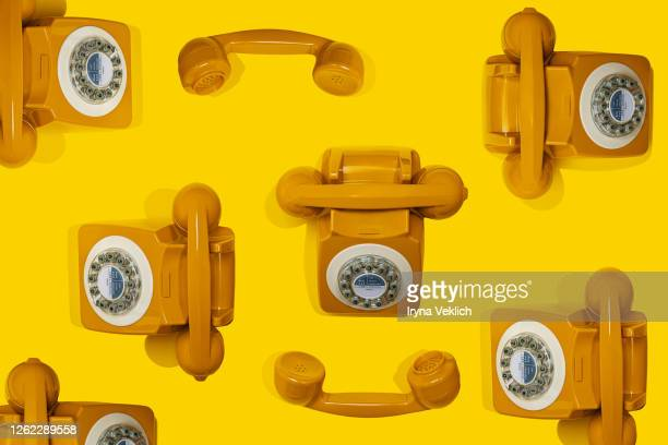 pattern made of yellow handset of a retro telephone. - the past stock pictures, royalty-free photos & images