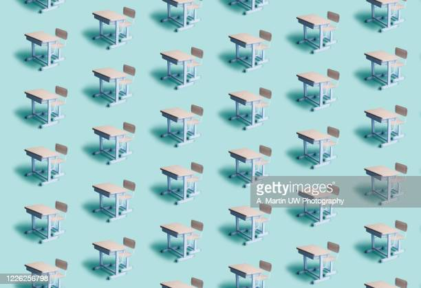 pattern of empty school desks on a blue background. social distancing concept. - 教育 ストックフォトと画像