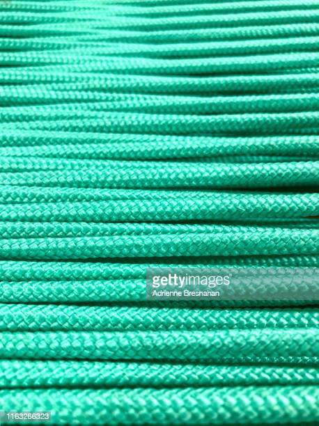 pattern of green cords - mesh textile stock pictures, royalty-free photos & images