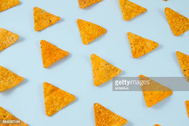 pattern of nachos - nachos stock pictures, royalty-free photos & images