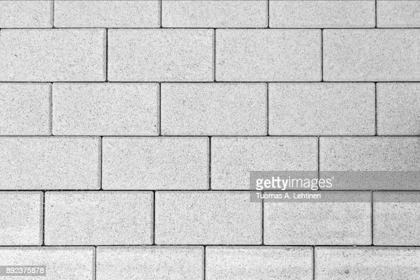 pattern of paving blocks viewed from above in black and white. - paving stone stock pictures, royalty-free photos & images