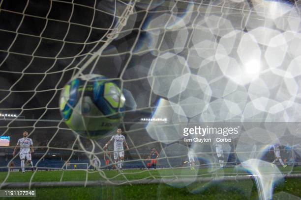 November 30: A pattern of rain drops on the lens as the ball hits the back of the net from a shot from Gaetan Laborde of Montpellier watched by...