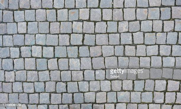 pattern of square paving stone on the ground - low section stock pictures, royalty-free photos & images