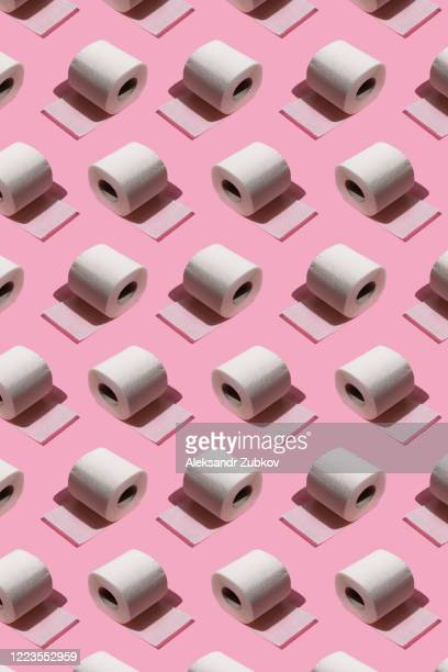pattern of toilet paper on a pink background. isometric view. - toilet paper stock pictures, royalty-free photos & images