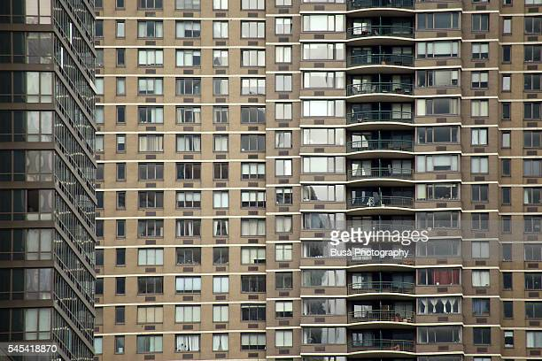 Pattern of windows of a massive residential building near Cooper Square in Manhattan, New York City