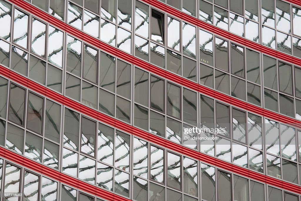 Pattern on the exterior wall of a modern glass building : Stock Photo