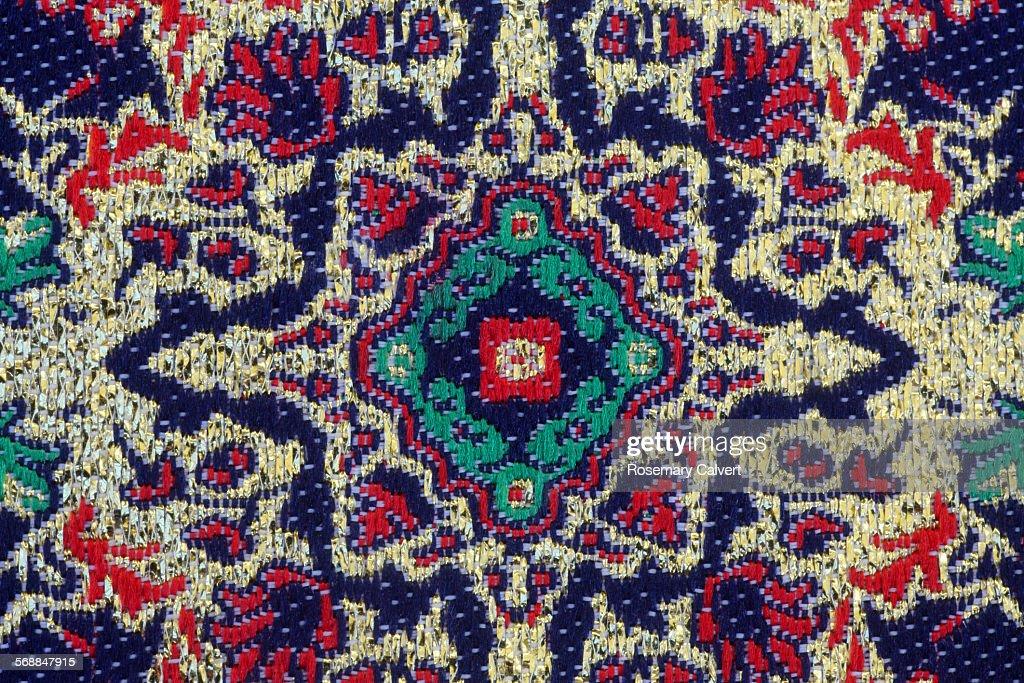 Pattern on woven Turkish fabric close up : Stock Photo