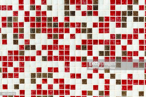 Pattern or texture made of small redwhite and black tiles