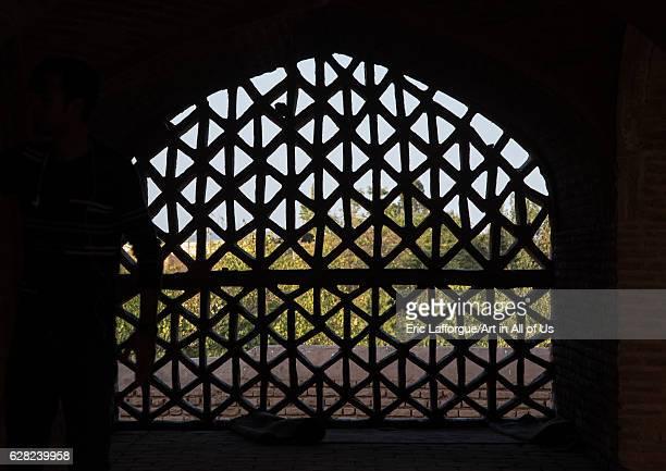 Pattern window at Jameh mosque Isfahan Province Ardestan Iran on October 19 2016 in Ardestan Iran