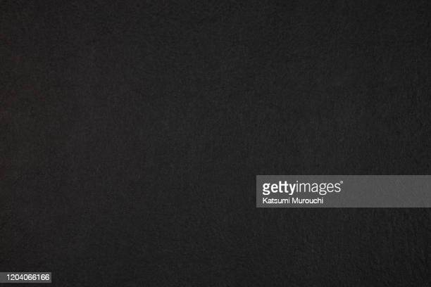 patterned black paper texture background - black colour stock pictures, royalty-free photos & images