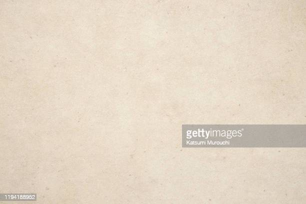 patterned paper texture background - beige foto e immagini stock