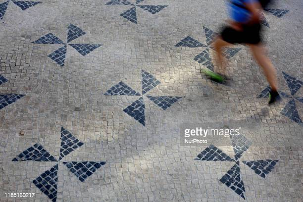 A patterned pavement is pictured in Lisbon Portugal on August 19 2019 The Portuguese sidewalk dates back to the mid 19th century it is a...