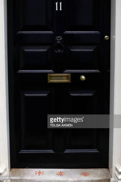 Patterns are pictured on the doorstep of 11 Downing Street after Britain's Chancellor of the Exchequer Rishi Sunak left to present the government's...