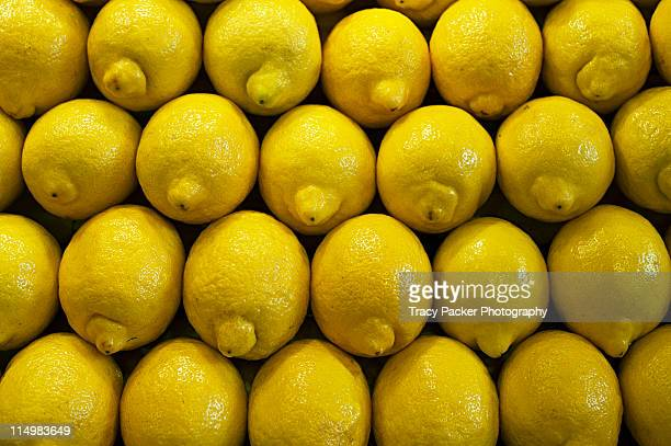 Patterns made by stacked fresh lemons