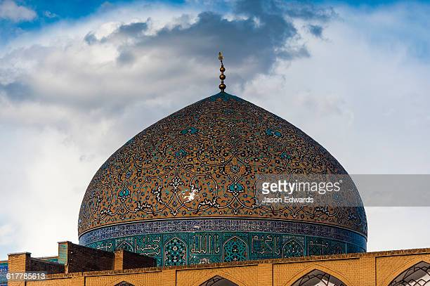 Patterns on the intricate tiled dome of the Sheikh Lotfollah Mosque at sunset.