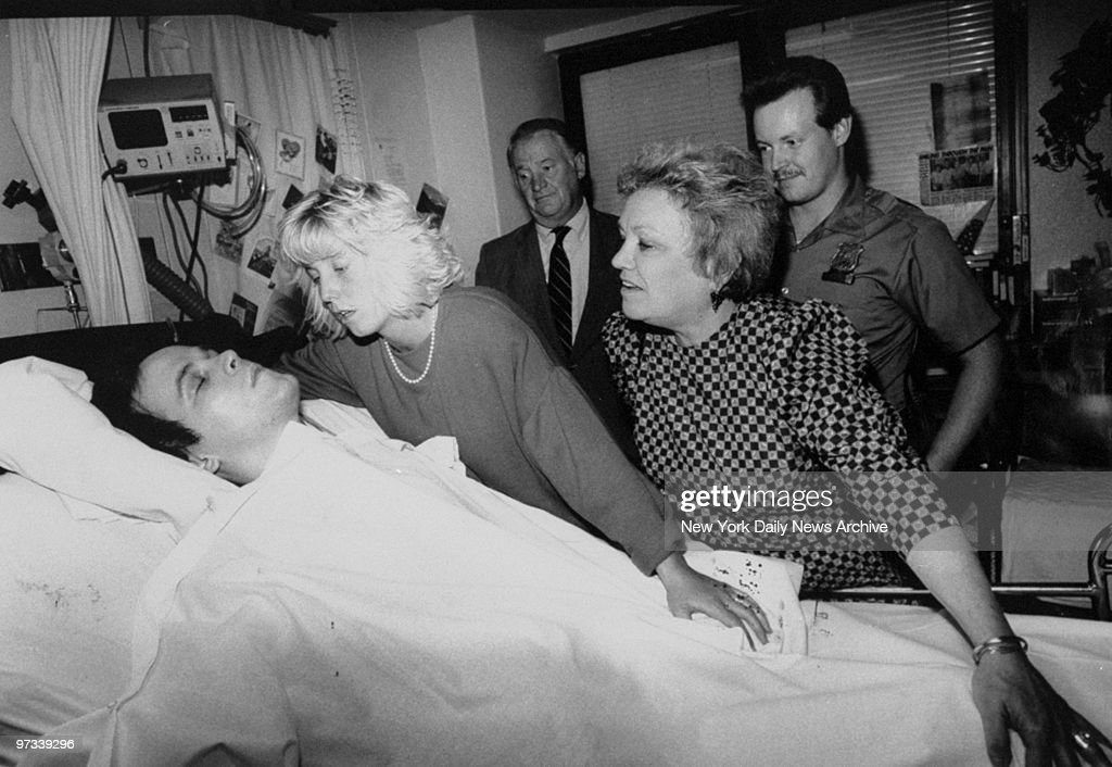 Patti Ann, wife of paralyzed cop Steven McDonald, and his mother, Anita, pray for his recovery at his bedside in Bellevue Hospital.