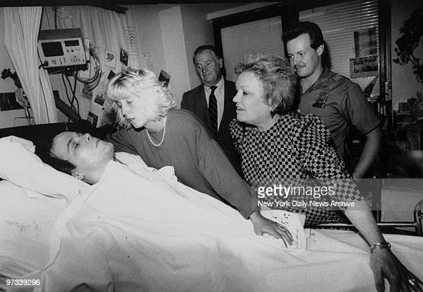 Patti Ann wife of paralyzed cop Steven McDonald and his mother Anita pray for his recovery at his bedside in Bellevue Hospital