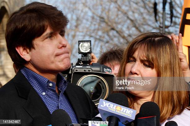 Patti Blagojevich wife of disgraced former Illinois Governor Rod Blagojevich looks at him while he pauses at a news conference outside his home March...