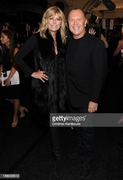 Patti Hansen and designer Michael Kors pose backstage at the Michael Kors Fall 2012 fashion show during MercedesBenz Fashion Week at The Theatre at...