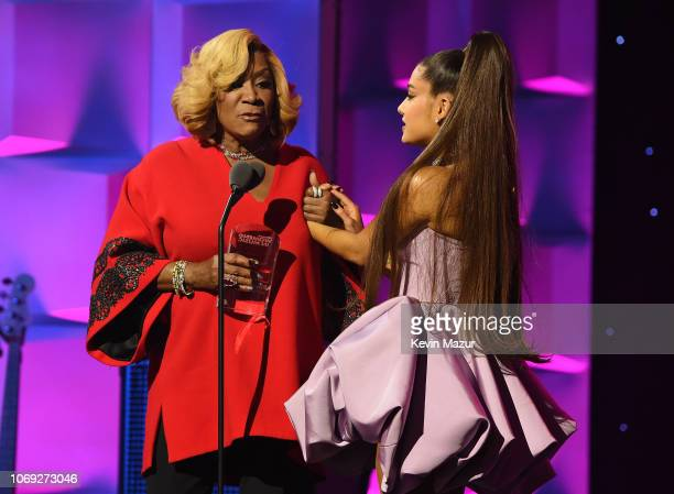 Patti LaBelle and Ariana Grande hug onstage at Billboard Women In Music 2018 on December 6 2018 in New York City