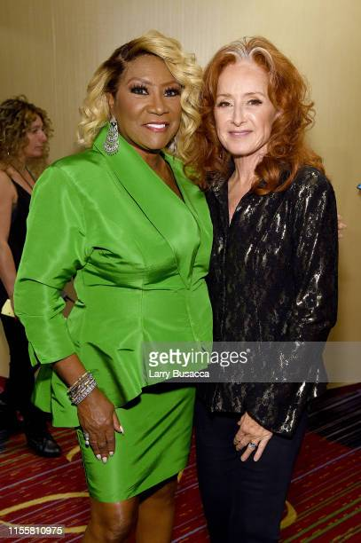 Patti LaBelle and Bonnie Raitt pose backstage during the Songwriters Hall Of Fame 50th Annual Induction And Awards Dinner at The New York Marriott...
