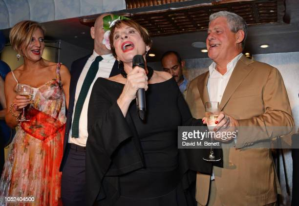 Patti LuPone leads a rendition of Happy Birthday to Sir Cameron Mackintosh as Marianne Elliott and Chris Harper look on at the press night after...