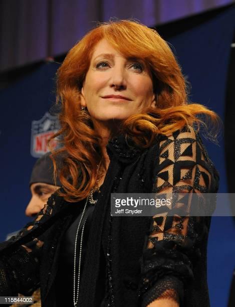 Patti Scialfa of the E Street Band speaks at the Bridgestone Super Bowl XVLII Half Time Show Press Conference held at the Tampa Convention Center on...