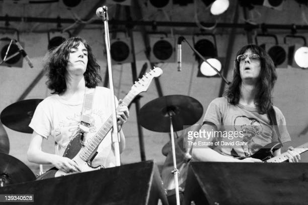 Patti Smith and Lenny Kaye of The Patti Smith Group perform on July 9 1976 at the Shaefer Music Festival in Central Park in New York City New York